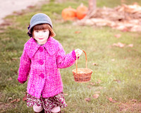 Little girl with basket from fall photo session at the Mill at Anselm, Chester Springs