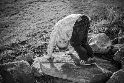 Little boy posing for a spring family photo shoot.