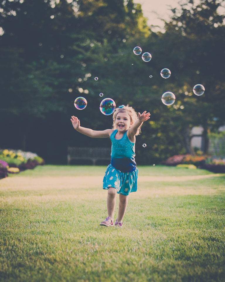 Photo of little girls chasing bubbles in Longwood Gardens