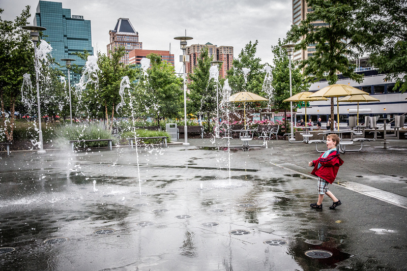 boy in Inner Harbor Baltimore by Chester County Photographer Annmarie Kopey